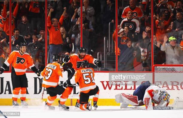 Brayden Schenn Shayne Gostisbehere and Jakub Voracek congratulate Valtteri Filppula of the Philadelphia Flyers of his first goal as a Flyer against...