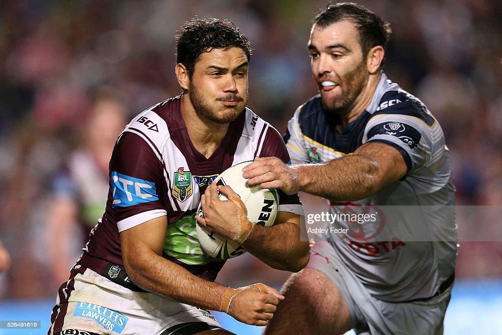 Brayden Wiliame of the Sea Eagles is tackled during the round nine NRL match between the Manly Sea Eagles and the North Queensland Cowboys at Brookvale Oval on April 30, 2016 in Sydney, Australia.