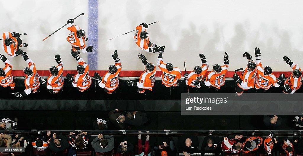 Braydon Coburn #5, Brayden Schenn #10, and Jakub Voracek #93 of the Philadelphia Flyers celebrate Voracek's goal against the Carolina Hurricanes with their bench on February 9, 2013 at the Wells Fargo Center in Philadelphia, Pennsylvania. The Flyers went on to defeat the Hurricanes 4-3 in OT.