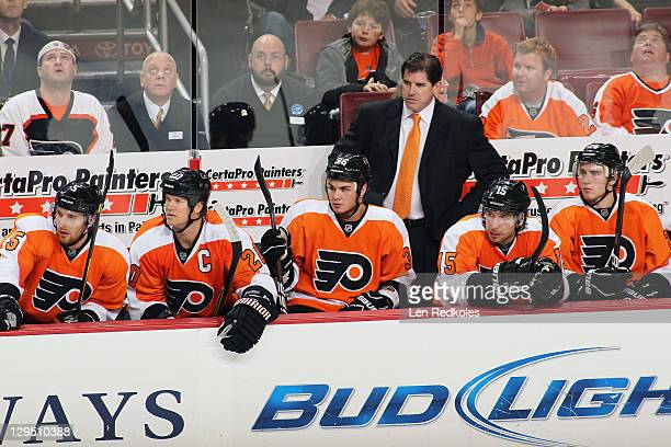 Braydon Coburn Chris Pronger Zac Rinaldo head coach Peter Laviolette Andreas Nodl and Matt Read of the Philadelphia Flyers watch the play from the...