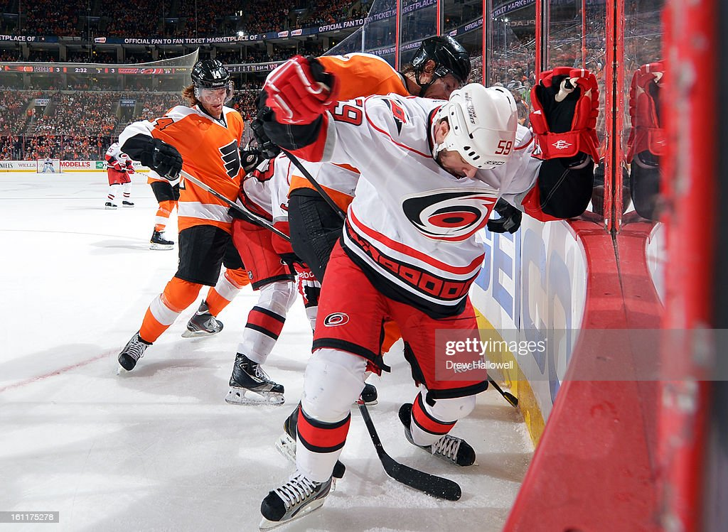 <a gi-track='captionPersonalityLinkClicked' href=/galleries/search?phrase=Braydon+Coburn&family=editorial&specificpeople=2077063 ng-click='$event.stopPropagation()'>Braydon Coburn</a> #5 of the Philadelphia Flyers and <a gi-track='captionPersonalityLinkClicked' href=/galleries/search?phrase=Chad+LaRose&family=editorial&specificpeople=546026 ng-click='$event.stopPropagation()'>Chad LaRose</a> #59 of the Carolina Hurricanes battle along the boards at the Wells Fargo Center on February 9, 2013 in Philadelphia, Pennsylvania. The Flyers won 4-3 in overtime.