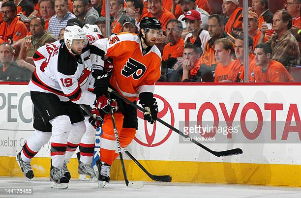 Braydon Coburn of the Philadelphia Flyers battles against Petr Sykora of the New Jersey Devils in Game Five of the Eastern Conference Semifinals...