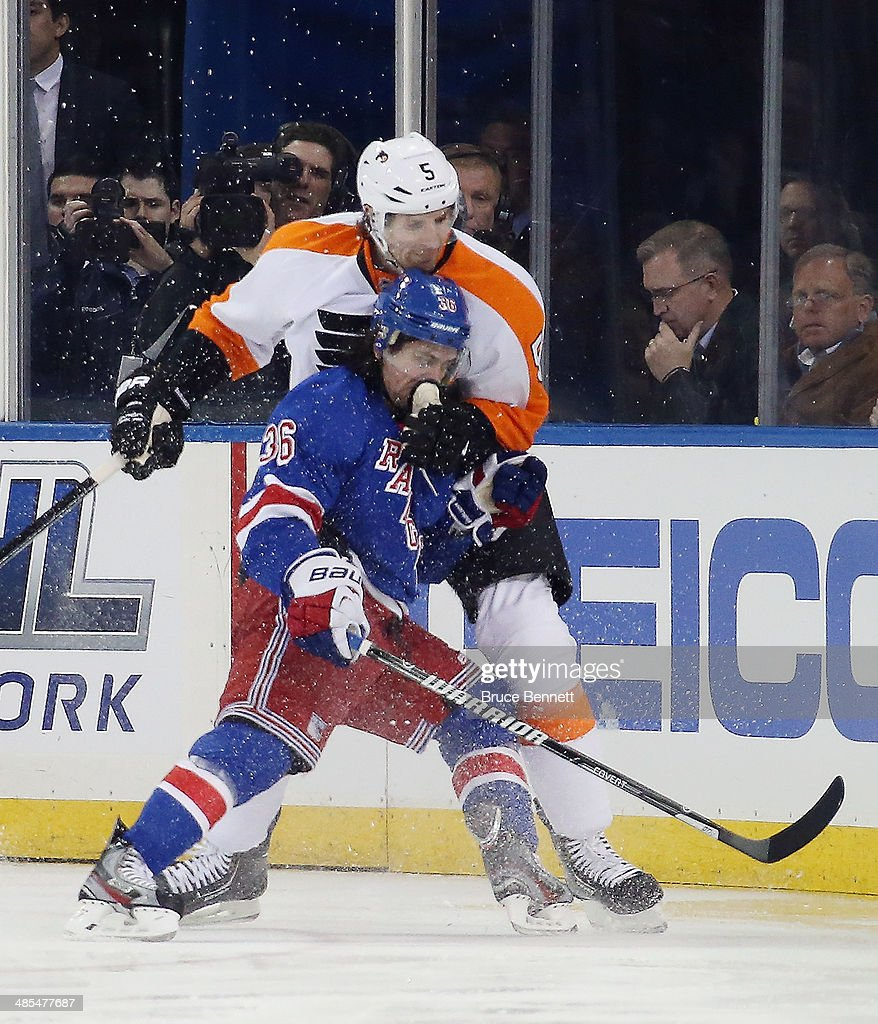 <a gi-track='captionPersonalityLinkClicked' href=/galleries/search?phrase=Braydon+Coburn&family=editorial&specificpeople=2077063 ng-click='$event.stopPropagation()'>Braydon Coburn</a> #5 of the Philadelphia Flyers gets his glove up on <a gi-track='captionPersonalityLinkClicked' href=/galleries/search?phrase=Mats+Zuccarello&family=editorial&specificpeople=7219903 ng-click='$event.stopPropagation()'>Mats Zuccarello</a> #36 of the New York Rangers in Game One of the First Round of the 2014 NHL Stanley Cup Playoffs at Madison Square Garden on April 17, 2014 in New York City. The Rangers defeated the Flyers 4-1.