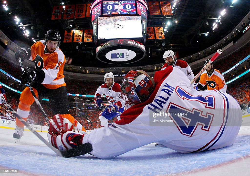 Braydon Coburn of the Philadelphia Flyers on his way to scoring a goal in the first period against goalie Jaroslav Halak of the Montreal Canadiens in...