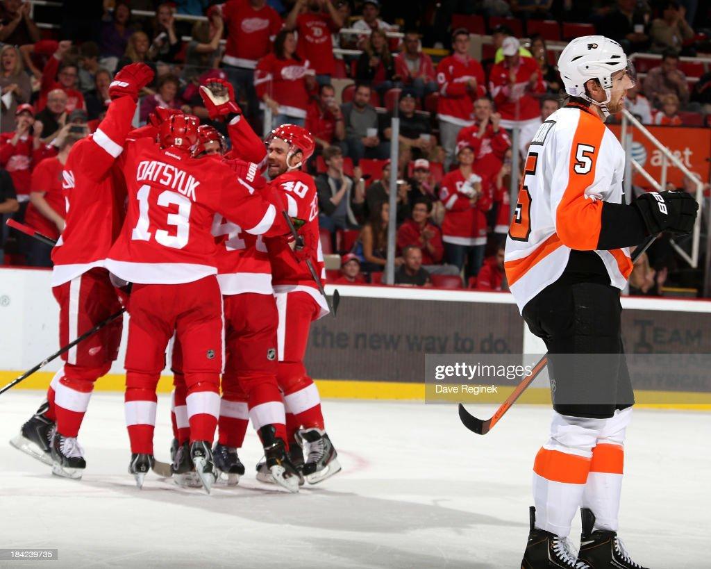Braydon Coburn of the Philadelphia Flyers skates to the bench as Jonathan Ericsson Niklas Kronwall Pavel Datsyuk and Henrik Zetterberg of the Detroit...