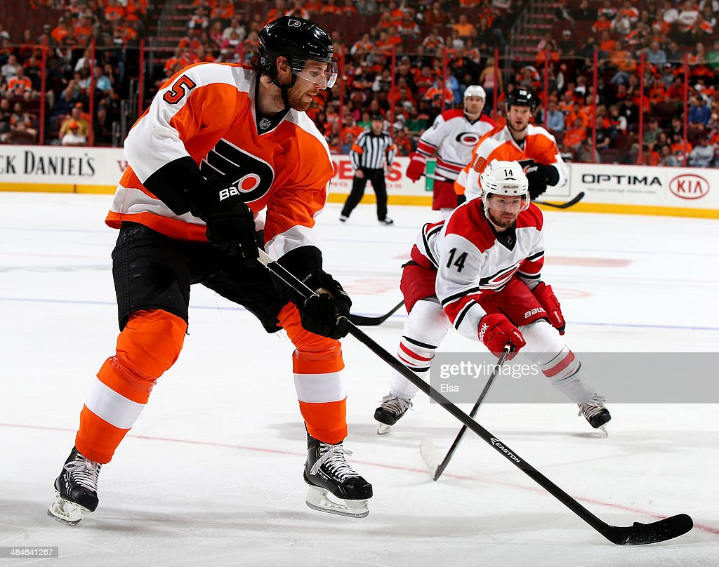 <a gi-track='captionPersonalityLinkClicked' href=/galleries/search?phrase=Braydon+Coburn&family=editorial&specificpeople=2077063 ng-click='$event.stopPropagation()'>Braydon Coburn</a> #5 of the Philadelphia Flyers takes the puck as <a gi-track='captionPersonalityLinkClicked' href=/galleries/search?phrase=Nathan+Gerbe&family=editorial&specificpeople=697084 ng-click='$event.stopPropagation()'>Nathan Gerbe</a> #14 of the Carolina Hurricanes defends in the first period at Wells Fargo Center on April 13, 2014 in Philadelphia, Pennsylvania.