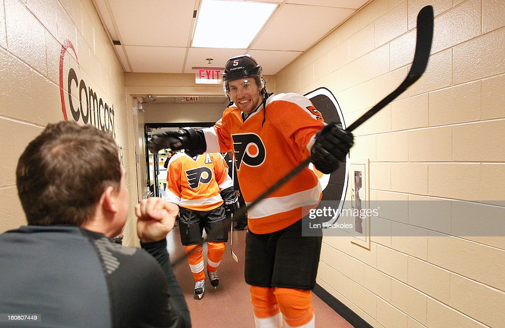 Braydon Coburn #5 of the Philadelphia Flyers walks by equipment manager Derek Settlemyre as he prepares to enter the ice surface for warm-ups prior to his game against the Carolina Hurricanes on February 2, 2013 at the Wells Fargo Center in Philadelphia, Pennsylvania.
