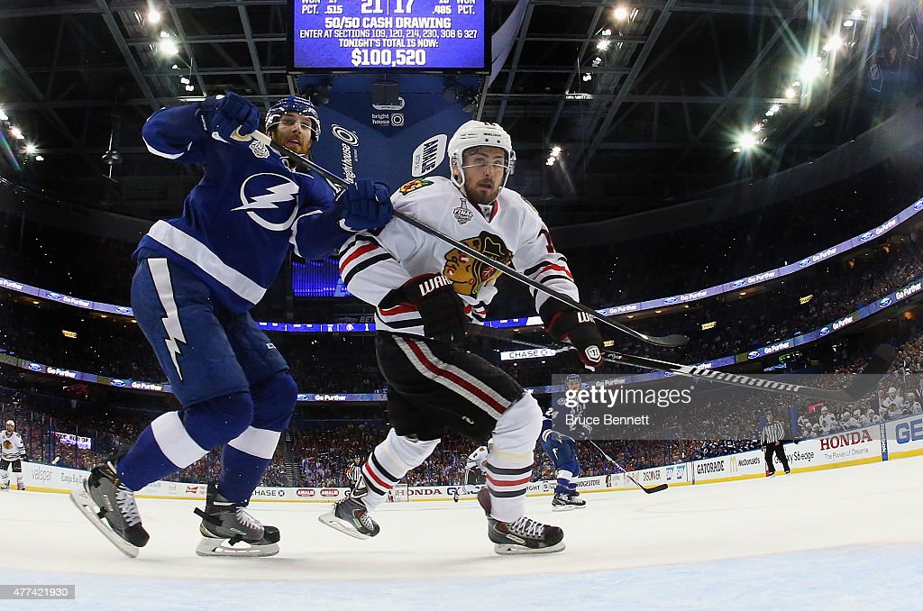 <a gi-track='captionPersonalityLinkClicked' href=/galleries/search?phrase=Braydon+Coburn&family=editorial&specificpeople=2077063 ng-click='$event.stopPropagation()'>Braydon Coburn</a> #55 of the Tampa Bay Lightning checks Marcus Kruger #16 of the Chicago Blackhawks during Game Five of the 2015 NHL Stanley Cup Final at Amalie Arena on June 13, 2015 in Tampa, Florida.