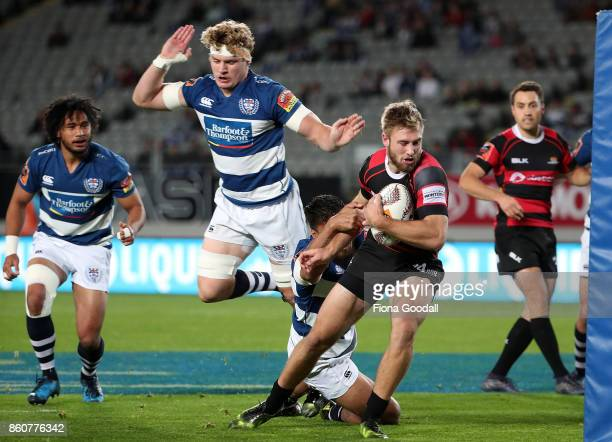Braydon Ennor of Canterbury heads in to score a try with Blake Gibson of Auckland in defence during the round nine Mitre 10 Cup match between...