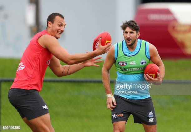 Braydon Preuss of the Kangaroos and Jarrad Waite of the Kangaroos compete for the ball during a North Melbourne Kangaroos AFL training session at...