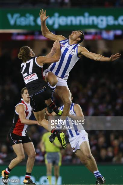 Braydon Preuss of the Kangaroos beats Josh Bruce of the Saints in the ruck contest during the round 22 AFL match between the St Kilda Saints and the...