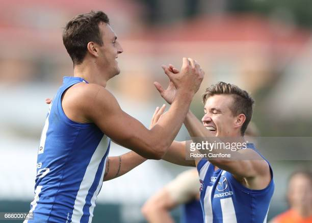 Braydon Preuss of the Kangaroos celebrates after scoring a goal during the round three AFL match between the North Melbourne Kangaroos and the...