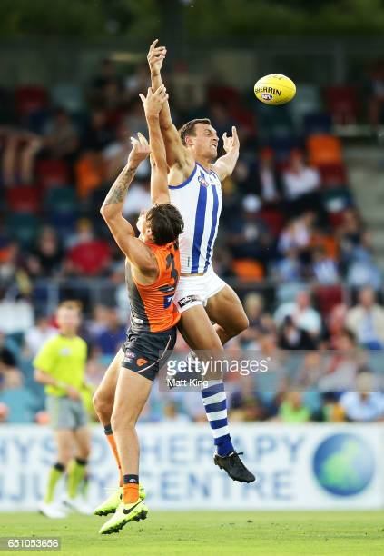 Braydon Preuss of the Kangaroos competes for the ball against Rory Lobb of the Giants during the JLT Community Series AFL match between the Greater...