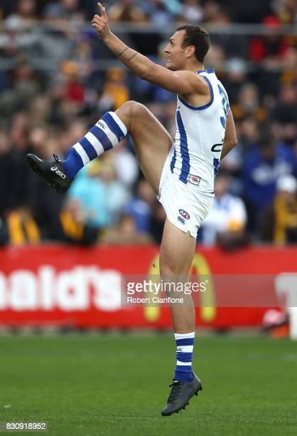 Braydon Preuss of the Kangaroos kicks on goal during the round 21 AFL match between the Hawthorn Hawks and the North Melbourne Kangaroos at...