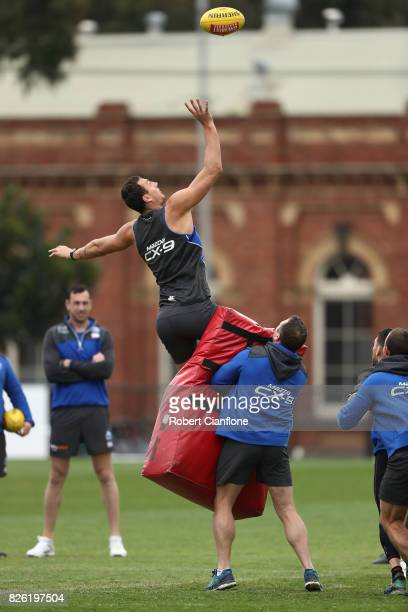 Braydon Preuss of the Kangaroos leaps for the ball during a North Melbourne Kangaroos AFL training session at Arden Street Ground on August 4 2017 in...