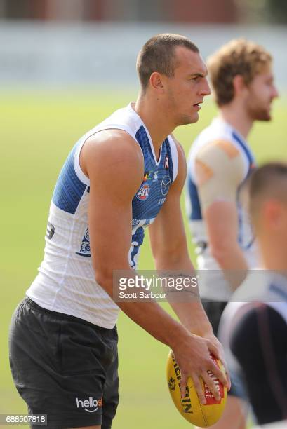 Braydon Preuss of the Kangaroos runs with the ball during a North Melbourne Kangaroos AFL training session at Arden Street Ground on May 26 2017 in...