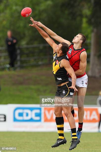 Braydon Preuss of Werribee and Samuel Draper of Essendon compete in the air during the round three VFL match between Werribee and Essendon at North...