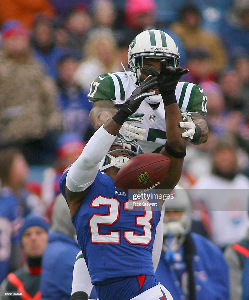 Braylon Edwards #17 of the New York Jets and Aaron Williams #23 of the Buffalo Bills can't make a catch at Ralph Wilson Stadium on December 30, 2012 in Orchard Park, New York. Buffalo won 28-9.