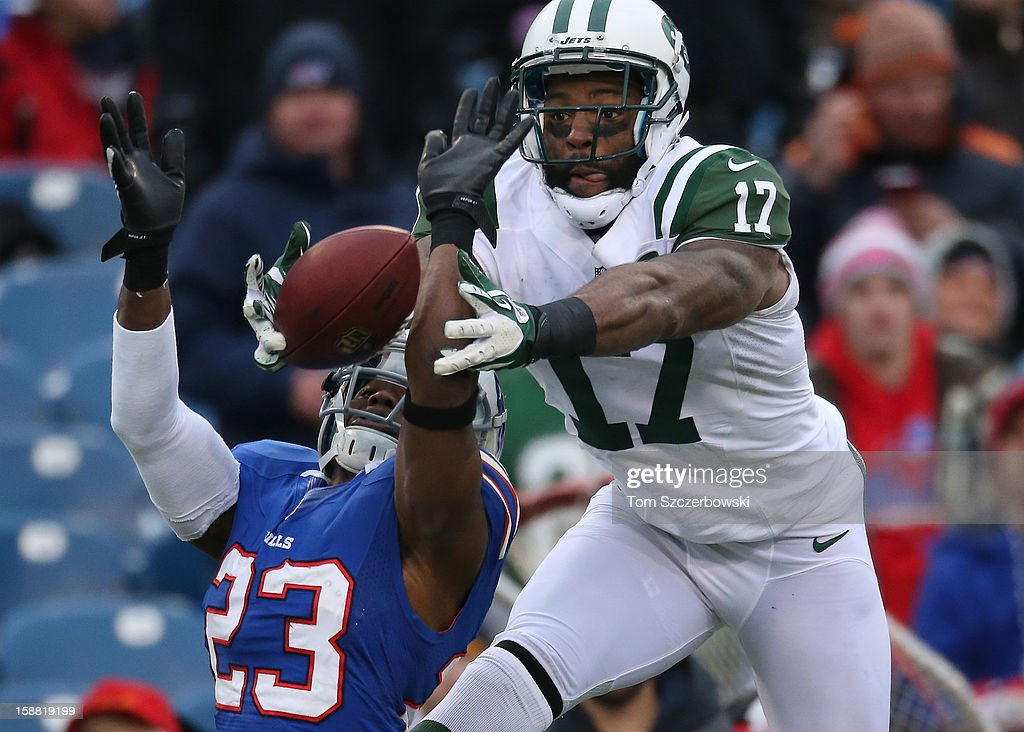 Braylon Edwards #17 of the New York Jets cannot haul in the ball for a catch during an NFL game as Aaron Williams #23 of the Buffalo Bills defends at Ralph Wilson Stadium on December 30, 2012 in Orchard Park, New York.