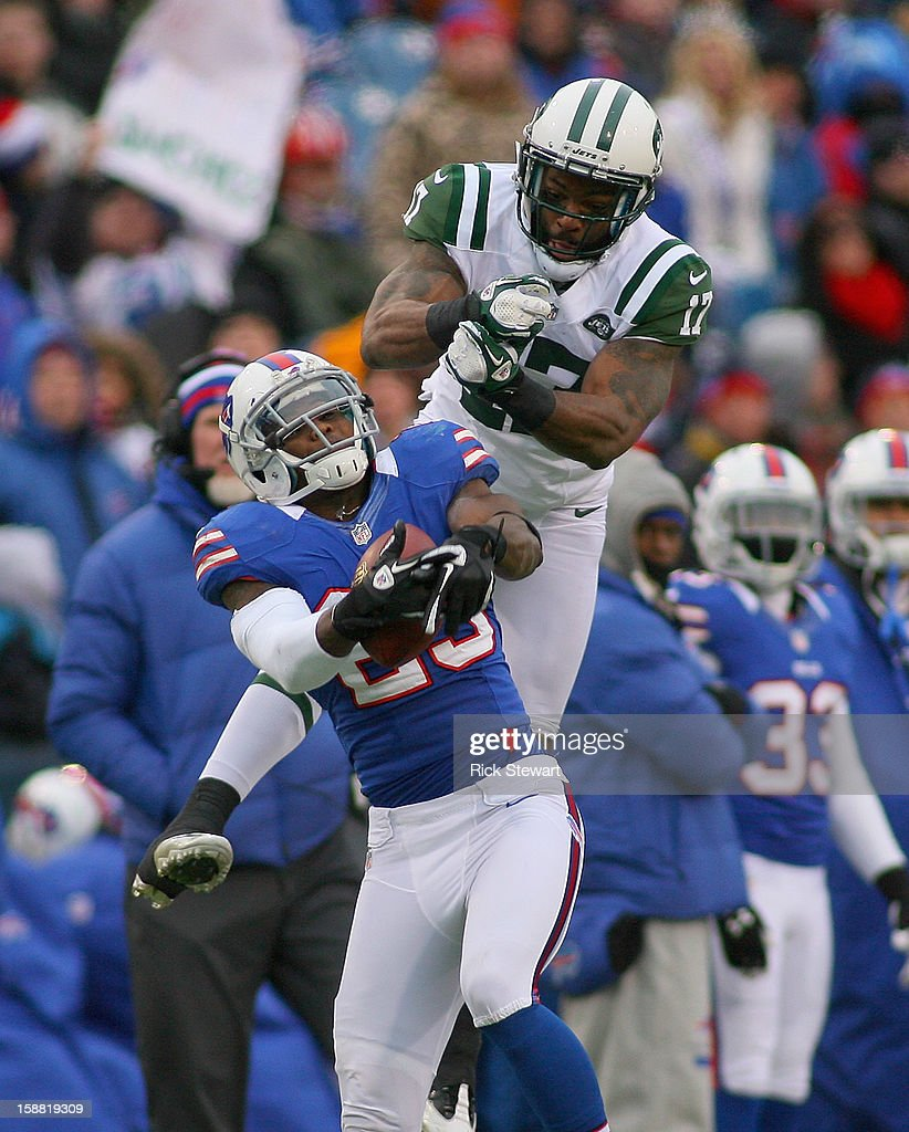 Braylon Edwards #17 of the New York Jets lets the ball slip through his hands as Aaron Williams #23 of the Buffalo Bills defends at Ralph Wilson Stadium on December 30, 2012 in Orchard Park, New York. Buffalo won 28-9.