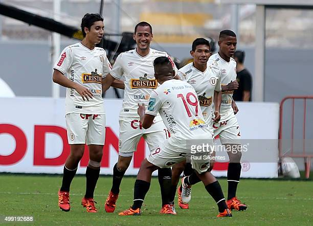 Braynner Garcia of Universitario celebrates with his teammates the second goal of his team against Sporting Cristal during a match between Sporting...