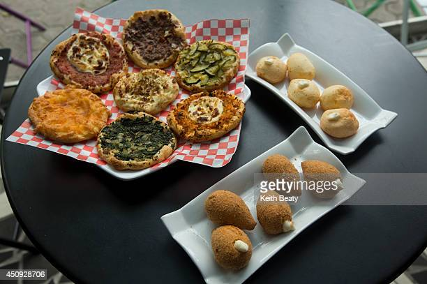 Braz1L Esfihas House a new Brazilian cafe/World Cup hotspot Photo of signature dish esfihas a plate of pao de queijo and a fried chicken snack called...