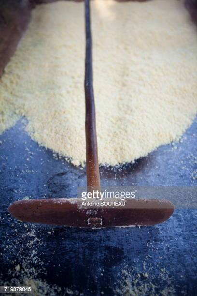 Brazil, Amapa, Raclette rodo conscript used to aerate the manioc flour during its cooking, Ribeirinhos people living in Amazonia along the river Araguari