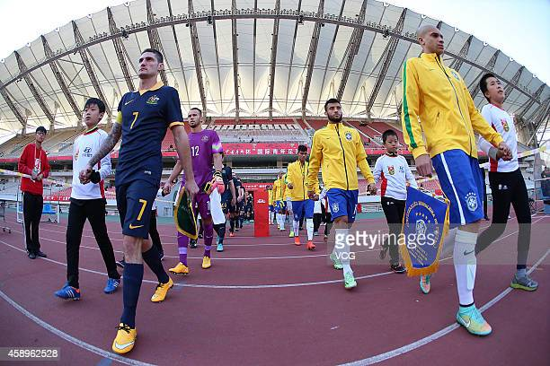 Brazil and Australia players arrives at the pitch prior to the match between Brazil U22 and Australia U22 on day one of the 'Wuhan City of...