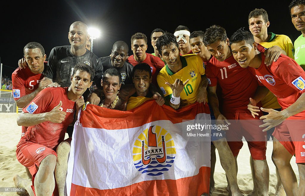 Brazil and Tahiti players celebrate at the end of the FIFA Beach Soccer World Cup Tahiti 2013 3rd Place Playoff match between Brazil and Tahiti at the Tahua To'ata Stadium on September 28, 2013 in Papeete, French Polynesia.