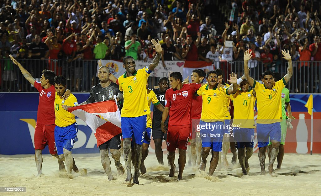 Brazil and Tahiti players do a lap of honour at the end of the FIFA Beach Soccer World Cup Tahiti 2013 3rd Place Playoff match between Brazil and Tahiti at the Tahua To'ata Stadium on September 28, 2013 in Papeete, French Polynesia.