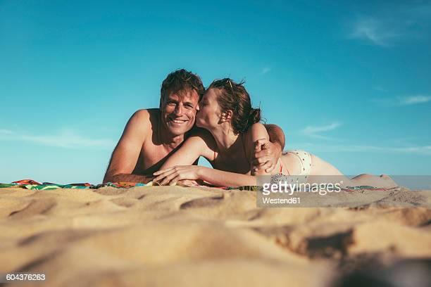 Brazil, Bahia, couple in love lying on the beach