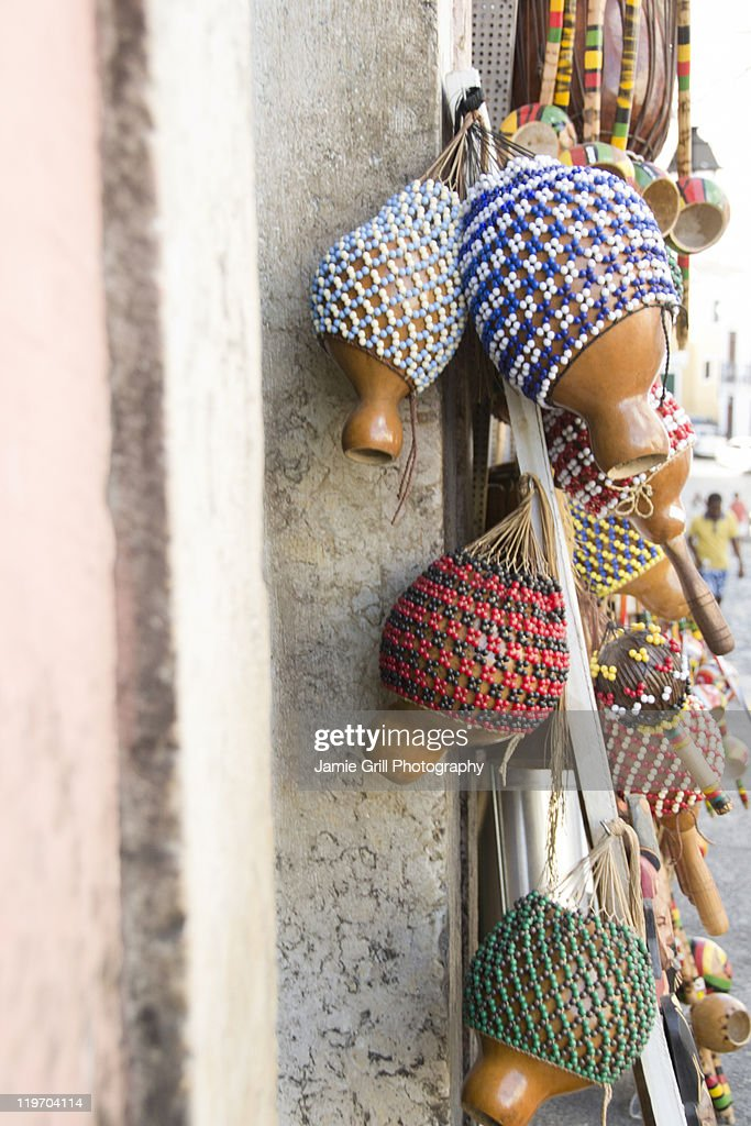 Brazil, Bahia, Salvador De Bahia, Rattles hanging against wall, close-up