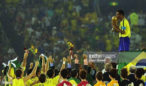 Brazil captain Cafu celebrates on the podium with the World Cup trophy after the World Cup Final match against Germany played at the International...
