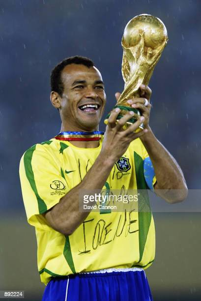 Brazil captain Cafu lifts the trophy after the Germany v Brazil World Cup Final match played at the International Stadium Yokohama in Yokohama Japan...