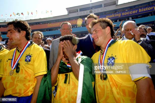 Brazil captain Dunga puts his arm around Romario who is overcome with emotion after Brazil's fourth World Cup final victory Fellow Brazilian and FIFA...