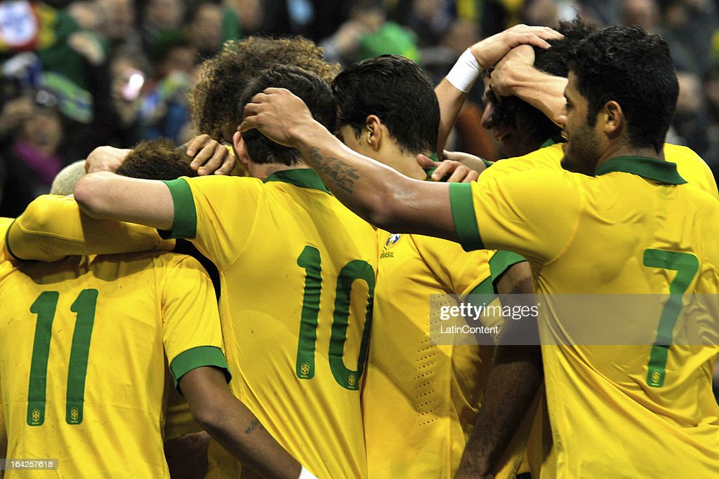 Brazil celebrate after scoring their first goal during the FIFA friendly match between Brazil and Italy on March 21, 2013 in Geneva, Switzerland.