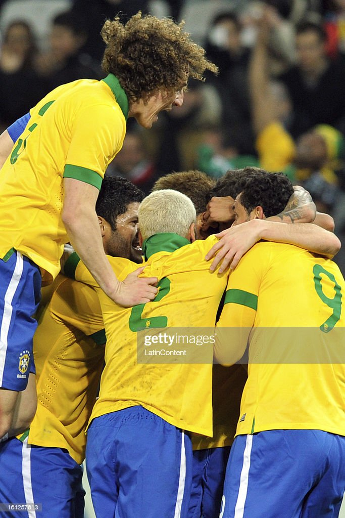 Brazil celebrate after scoring their second goal during the FIFA friendly match between Brazil and Italy on March 21, 2013 in Geneva, Switzerland.