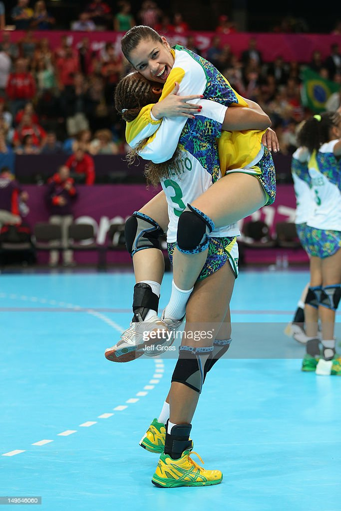 Brazil celebrate victory after the Women's Handball Preliminaries Group A - Match 11 between Brazil and Montenegro on Day 3 of the London 2012 Olympic Games at the Copper Box on July 30, 2012 in London, England.