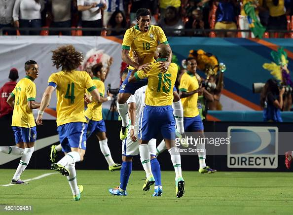 Brazil celebrates a goal by Bernard during a friendly between Brazil and Honduras at Sun Life Stadium on November 16 2013 in Miami Gardens Florida