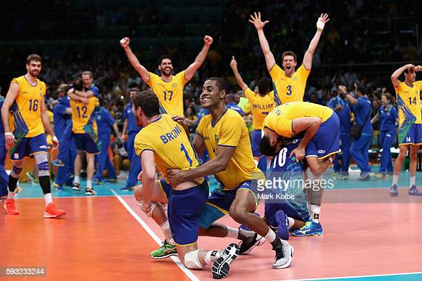 Brazil celebrates after winning the Men's Gold Medal Match between Italy and Brazil on Day 16 of the Rio 2016 Olympic Games at Maracanazinho on...