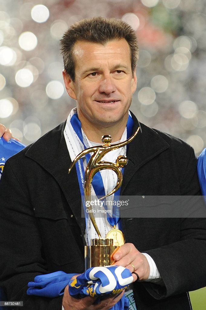 Brazil coach Dunga holds a trophy during the 2009 Confederations Cup final match between Brazil and USA from Ellis Park on June 28 2009 in...