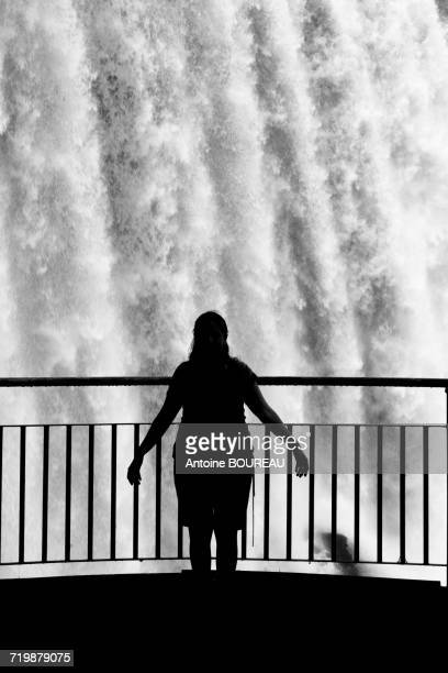Brazil, Falls of Iguazu seen from the Brazilian side and silhouette of a tourist seen from behind