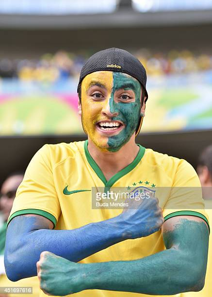 Brazil fan enjoys the atmosphere prior to the 2014 FIFA World Cup Brazil Quarter Final match between Brazil and Colombia at Castelao on July 4 2014...