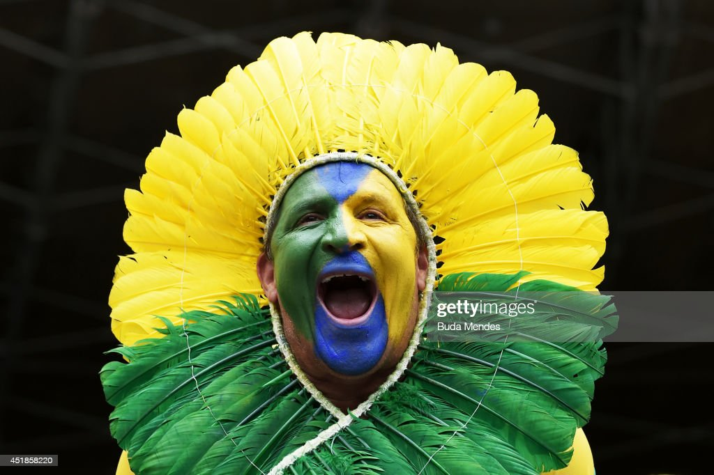 A Brazil fan enjoys the atmosphere prior to the 2014 FIFA World Cup Brazil Semi Final match between Brazil and Germany at Estadio Mineirao on July 8, 2014 in Belo Horizonte, Brazil.