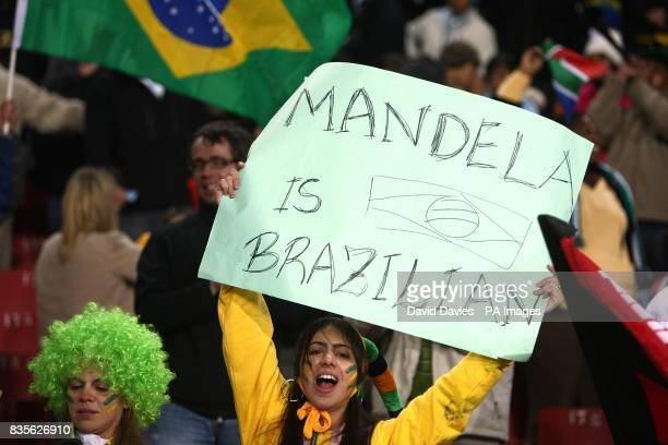 A Brazil fan holds a banner aloft in the stands at Ellis Park
