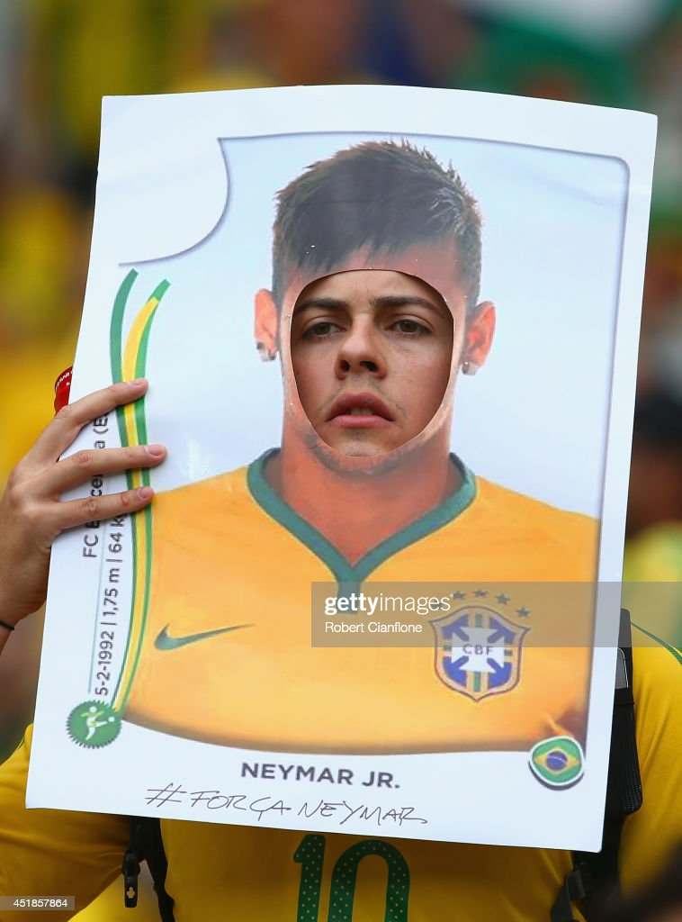 A Brazil fan holds a sticker cutout of Neymar of Brazil during the 2014 FIFA World Cup Brazil Semi Final match between Brazil and Germany at Estadio Mineirao on July 8, 2014 in Belo Horizonte, Brazil.