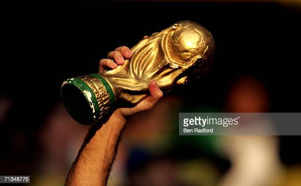 Brazil fan holds aloft a replica of the world cup trophy prior to kickoff during the FIFA World Cup Germany 2006 Quarterfinal match between Brazil...