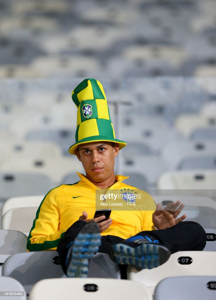 A Brazil fan reacts after the 1-7 defeat in the 2014 FIFA World Cup Brazil Semi Final match between Brazil and Germany at Estadio Mineirao on July 8, 2014 in Belo Horizonte, Brazil.