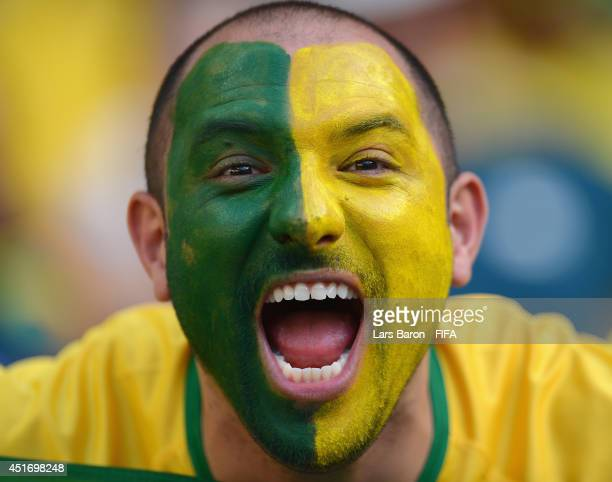 Brazil fan soaks up the atmosphere prior to the 2014 FIFA World Cup Brazil Quarter Final match between Brazil and Colombia at Estadio Castelao on...