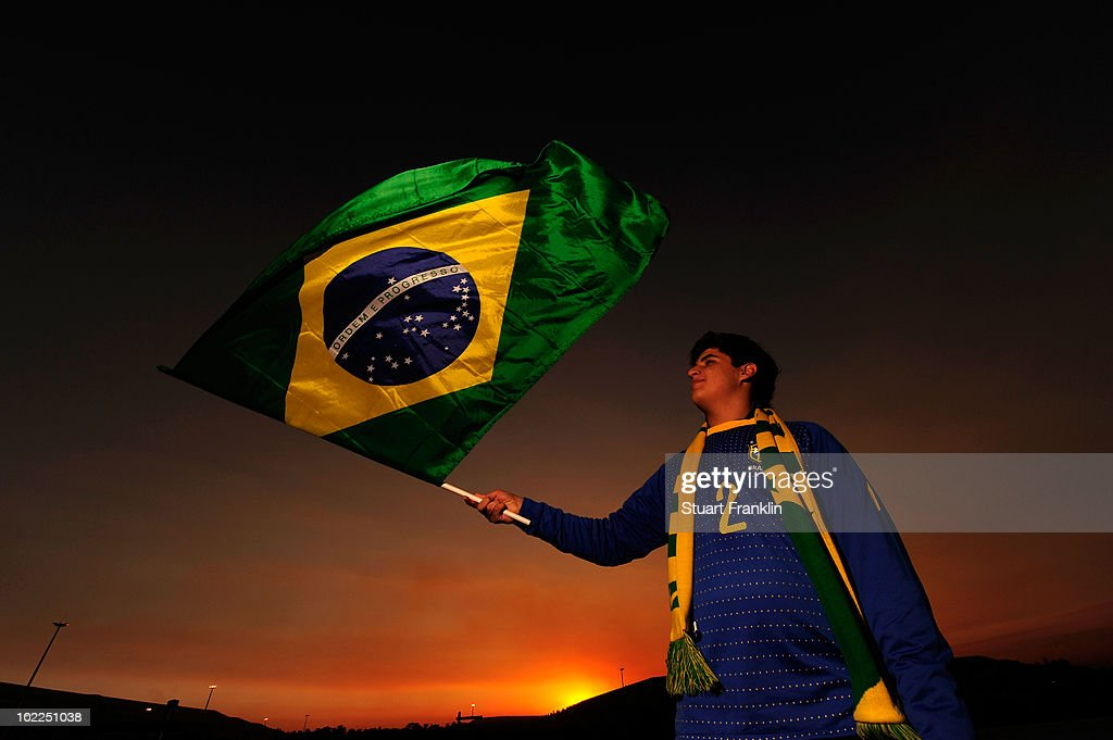 A Brazil fan waves her national flag ahead of the 2010 FIFA World Cup South Africa Group G match between Brazil and Ivory Coast at Soccer City Stadium on June 20, 2010 in Johannesburg, South Africa.